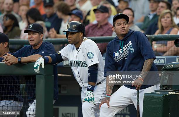 From left Seattle Mariners hitting coach Edgar Martinez Robinson Cano of the Seattle Mariners and Felix Hernandez of the Seattle Mariners watch play...