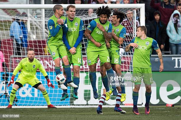 From left Seattle Sounders players Osvaldo Alonso Chad Marshall Roman Torres Nelson Haedo Valdez and Jordan Morris leap to block a free kick during...