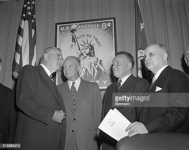 Secretary of State, John Foster Dulles; President Eisenhower; Postmaster General, Arthur Summerfield; and Dr. Roy G. Ross of the National Council of...