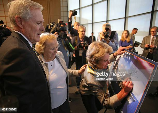 From left Secretary of the Navy Ray Mabus Ethel Kennedy and Kathleen Kennedy Townsend Ethel Kennedys daughter sign a photo of the ship that will be...