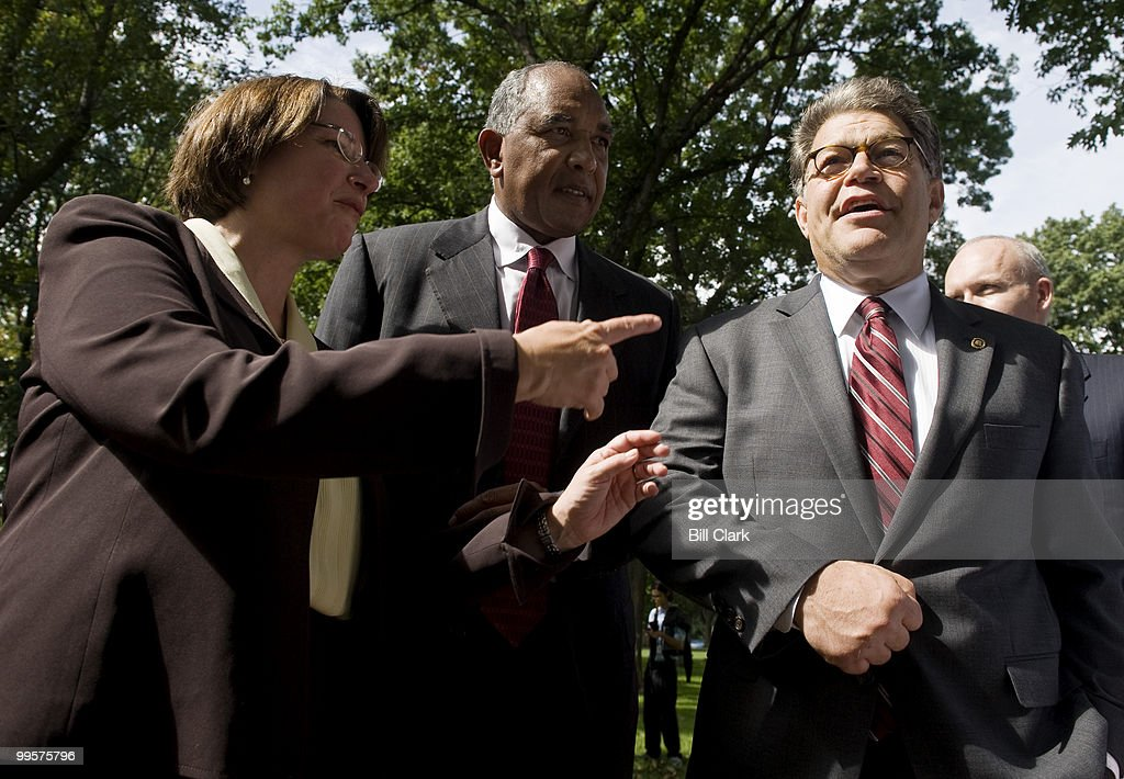 From left, Sen. Amy Klobuchar, D-Minn., University of Minnesota head basketball coach Tubby Smith, and Sen. Al Franken, D-Minn., talk after the conclusion of the Coaches vs. Cancer rally to 'urge Congress to pass health care reform' on Tuesday, Sept. 22, 2009, in Upper Senate Park.