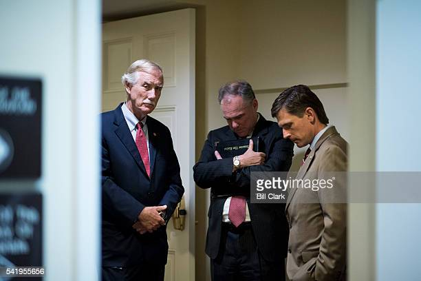 From left Sen Angus King Sen Tim Kaine and Sen Martin Heinrich gather in a back hallway as they wait for Sen Susan Collins and other senators to...