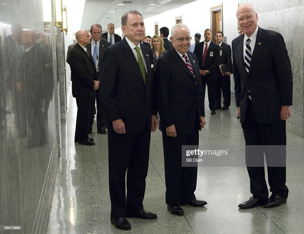 From left, Sen. Arlen Specter, R-Pa., U.S. Attorney General nominee Michael Mukasey, and chairman Patrick Leahy, D-Vt., stop for a photo-op as they arrive for the Senate Judiciary Committee hearing on Mukasey's nomination to be attorney general of the United States on Wednesday, Oct. 17, 2007.