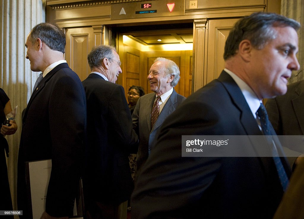 From left, Sen. Bob Casey, D-Pa., Sen. Chuck Grassley, R-Iowa, Sen. Joe Lieberman, I-Conn., and Sen. Mark Pryor, D-Ark., congregate by the elevators outside of the Senate floor before the start of the policy lunches in the Capitol on Tuesday, June 3, 2008.