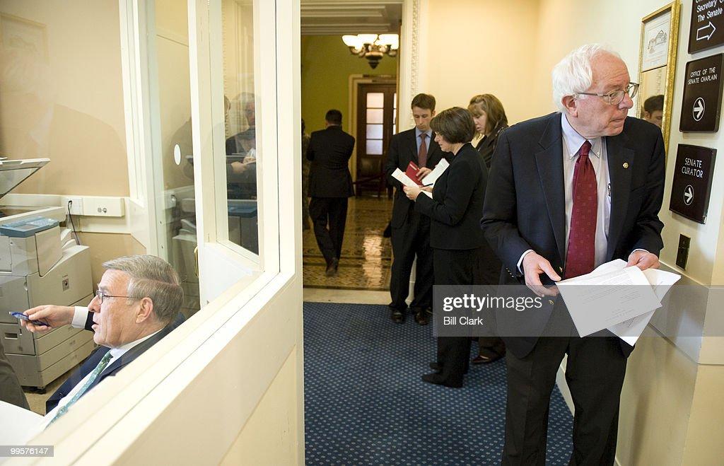From left, Sen. Byron Dorgan, D-N. Dak., Sen. Amy Klobuchar, D-Minn., and Sen. Bernie Sanders, I-Vt., wait for Sen. Charles Schumer to arrive before the start of their news conference in the Senate Radio/TV Gallery studio on OPEC oil production on Thursday, April 24, 2008.