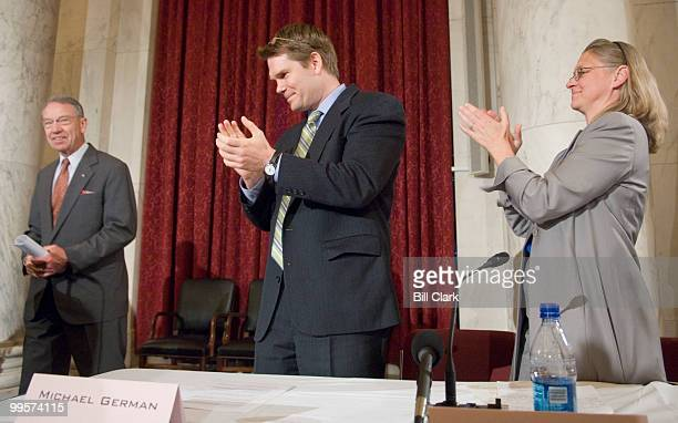 From left Sen Charles Grassley RIowa prepares to deliver the keynote address as FBI whistleblowers Michael German and Coleen Rowley clap during the...