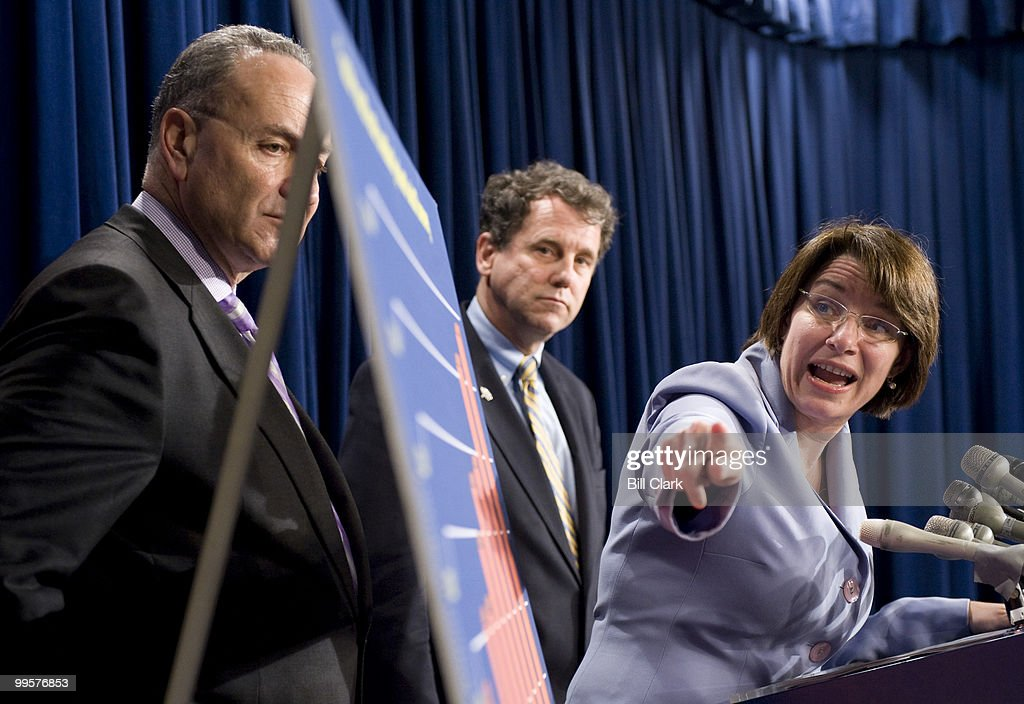 From left, Sen. Charles Schumer, D-N.Y., Sen. Sherrod Brown, D-Ohio, and Sen. Amy Klobuchar, D-Minn., hold a news conference to repsond to President Bush's news conference earlier in the day on Tuesday, April 29, 2008. Sen. Klobuchar is pointing to a chart showing rising gas and oil prices.