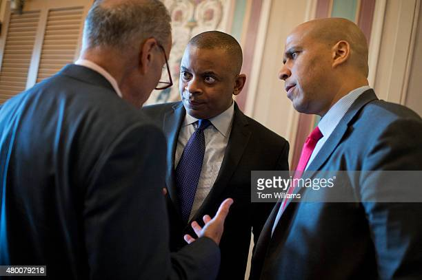 From left Sen Charles Schumer DNY Transportation Secretary Anthony Foxx and Sen Cory Booker DNJ confer before a news conference in the Capitol to...