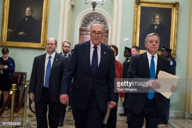 From left Sen Chris Coons DDel Senate Minority Leader Charles Schumer DNY and Minority Whip Richard Durbin DIll arrive for a news conference after...