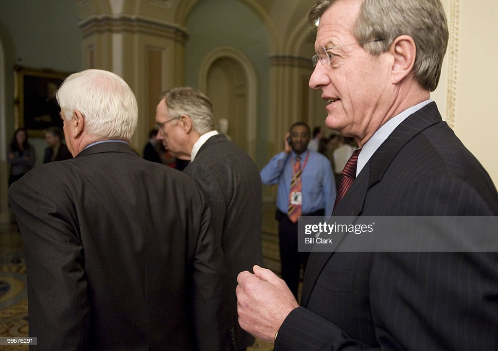 From left, Sen. Chris Dodd, D-Conn., Senate Majority Leader Harry Reid, D-Nev., and Sen. Max Baucus, D-Mont., leave the Senate Democratic Policy lunch to speak with reporters in the Ohio Clock Corridor on Tuesday, Oct. 20, 2009.