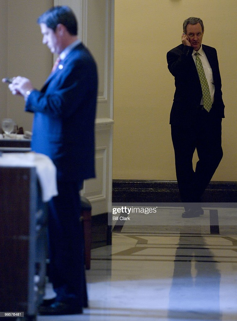 From left, Sen. David Vitter, R-La., types on his blackberry as Sen. Mike Crapo, R-Idaho, talks on his cell phone during the Republican Policy Luncheon in the Capitol on Tuesday, Feb. 5, 2008.