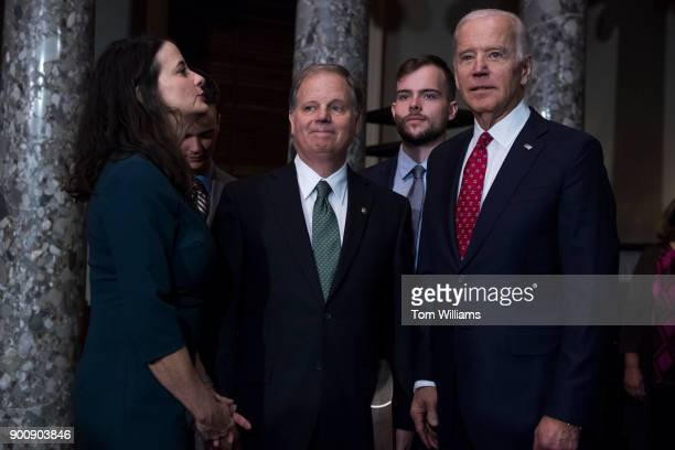 From left Sen Doug Jones DAla center is seen with former VP Joe Biden right Jones' son Carson second from right wife Louise and son Chris during a...