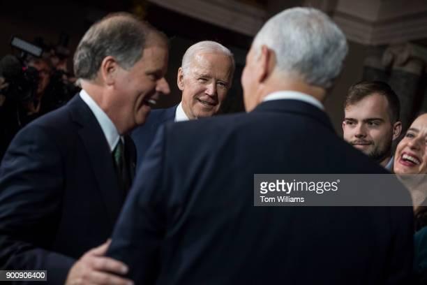 From left Sen Doug Jones DAla former VP Joe Biden Vice President Mike Pence Jones' son Carson and wife Louise are seen during a swearingin ceremony...