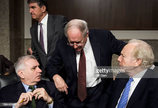 From left Sen Jack Reed DRI Chairman Carl Levin DMich and speak before the start of the Senate Armed Services Committee confirmation hearing on...