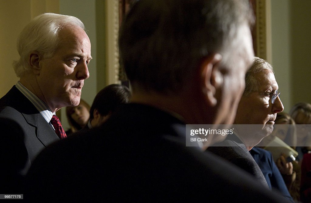 From left, Sen. John Cornyn, R-Texas, Senate Minority Whip Jon Kyl, R-Ariz., and Senate Minority Leader Mitch McConnell, R-Ky., speak to the gathered media in the Ohio Clock Corridor following the Senate Republican Policy Committee lunch meeting on Wednesday, Dec. 10, 2008.