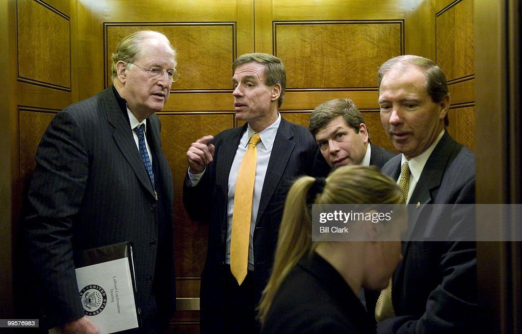 From left, Sen. John Rockefeller, D-W. Va., rides the elevator with freshman Senators Mark Warner, D-Va., Mark Begich, D-Alaska, and Tom Udall, D-N.M., following the Senate Democratic Policy lunch on Wednesday, Jan. 21, 2009.