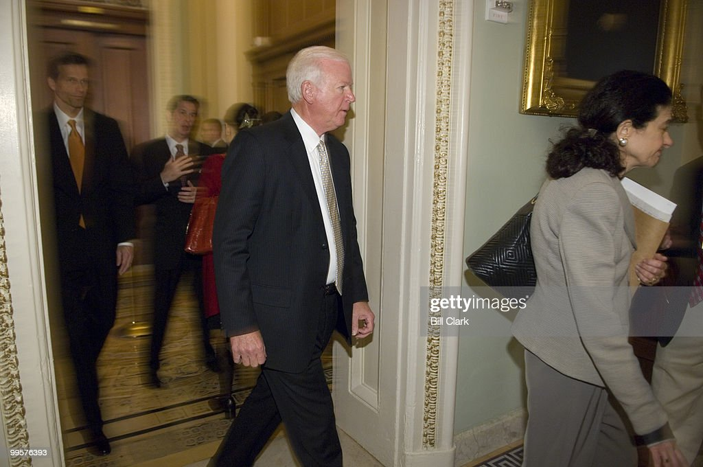 From left, Sen. John Thune, R-S. Dak., Sen. Saxby Chambliss, R-Ga., and Sen. Olympia Snowe, R-Maine, leave Sen. Kyl's Minority Whip office in the Capitol and make their way to the weekly Senate Republican Policy Committee luncheon in the Capitol on Tuesday, March 4, 2008. Sen. David Vitter, R-La., is in the background speaking with a reporter.