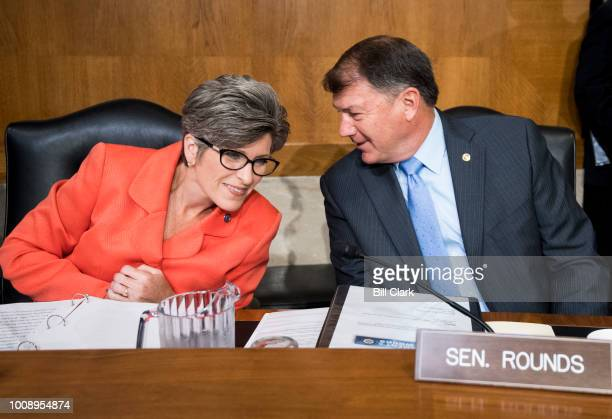 From left Sen Joni Ernst RIowa and Sen Mike Rounds RS Dak talk before the start testimony from Andrew Wheeler acting administrator at the...