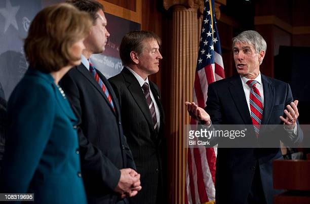 From left Sen Lisa Murkowski RAlaska Rep Heath Shuler DNC Rep Paul Gosar RAriz and Sen Mark Udall DColo hold a news conference on their effort to end...