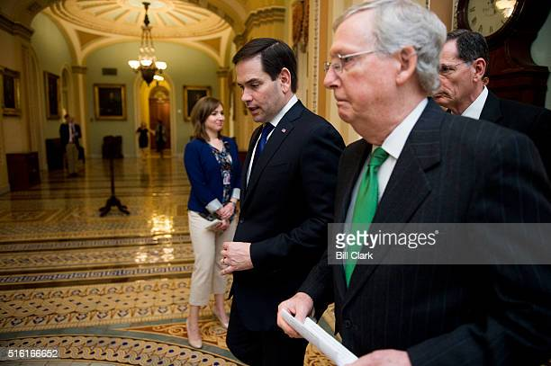 From left Sen Marco Rubio speaks with Senate Majority Leader Mitch McConnell and Sen John Barrasso as they head to the Senate floor for a vote on...