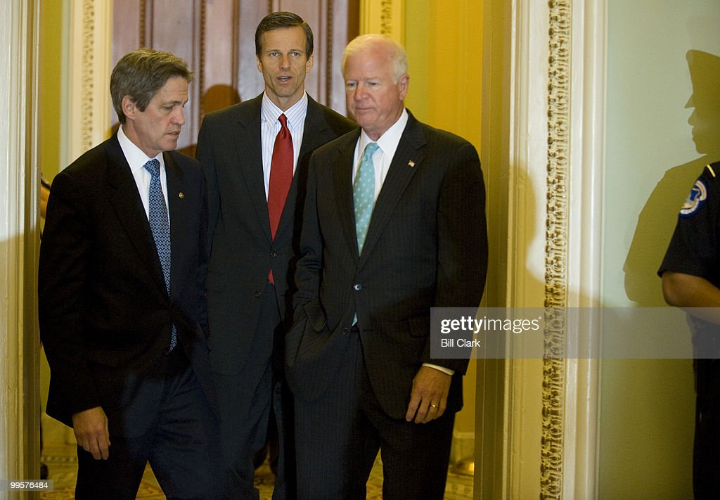 From left, Sen. Norm Coleman, R-Minn., Sen. John Thune, R-S. Dak., and Sen. Saxby Chambliss, R-Ga., talk as they arrive for the weekly Senate Republican Policy luncheon on Tuesday, April 15, 2008.