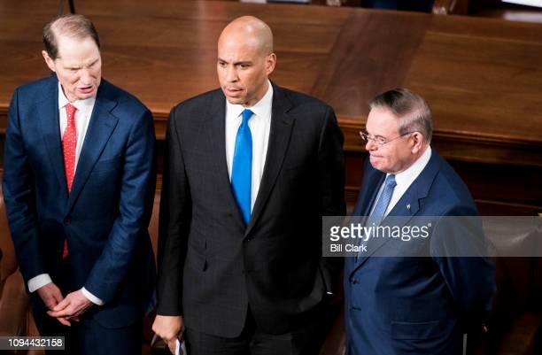 From left Sen Ron Wyden DOre Sen Cory Booker DNJ and Sen Bob Menendez DNJ talk in the House chamber before President Donald Trump's State of the...