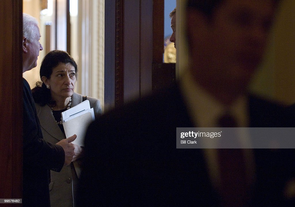 From left, Sen. Saxby Chambliss, R-Ga., Sen. Olympia Snowe, R-Maine, and Sen. John Thune, R-S. Dak., talk in the doorway of Sen. Kyl's Minority Whip office in the Capitol before making their way to the weekly Senate Republican Policy Committee luncheon in the Capitol on Tuesday, March 4, 2008.