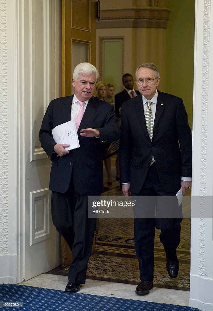 From left, Senate Banking, Housing and Urban Affairs Committee chairman Chris Dodd, D-Conn, and Majority Leader Harry Reid, D-Nev., arrive to speak about the financial crisis bailout plans during a news conference in the Senate Radio-TV Gallery studio on Friday, Sept. 26, 2008.