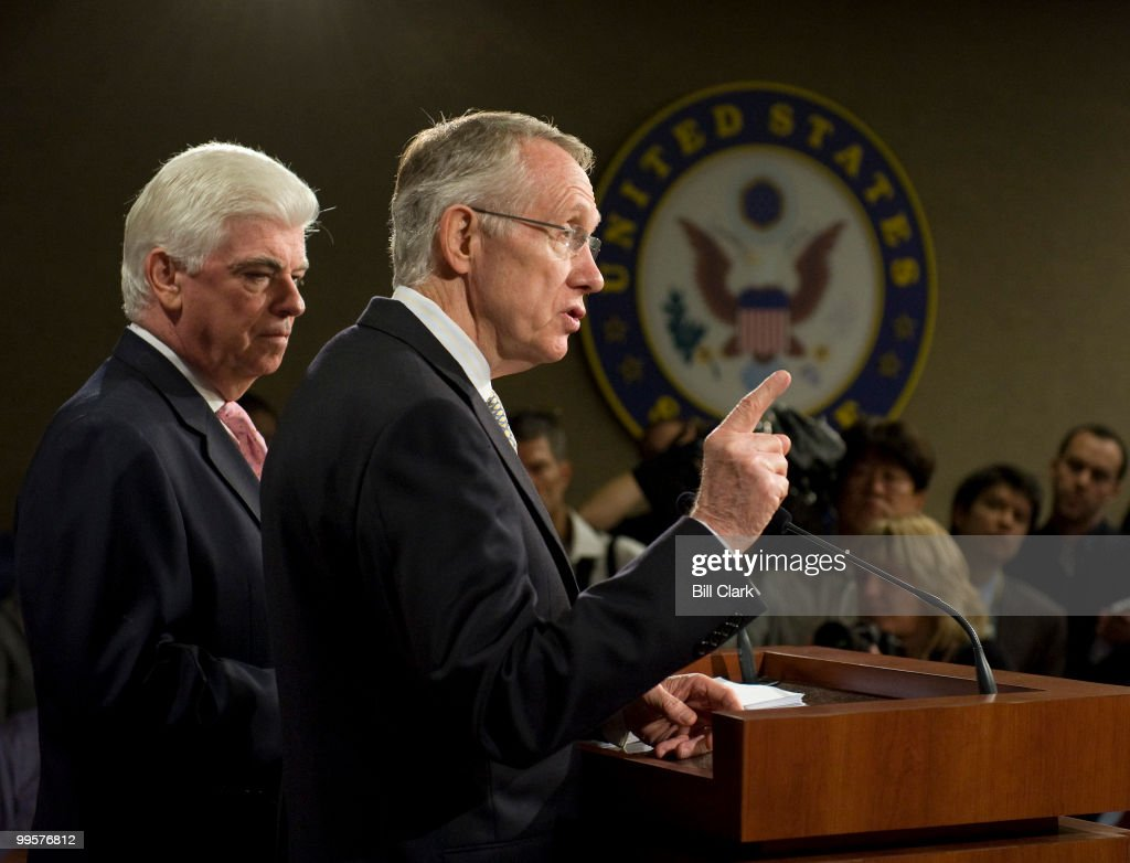 From left, Senate Banking, Housing and Urban Affairs Committee chairman Chris Dodd, D-Conn, and Majority Leader Harry Reid, D-Nev., speak about the financial crisis bailout plans during a news conference in the Senate Radio-TV Gallery studio on Friday, Sept. 26, 2008.