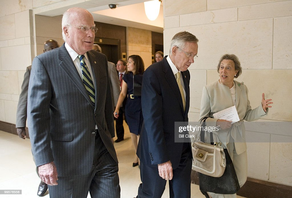 From left, Senate Judiciary Chairman Patrick Leahy, D-Vt., Senate Majority Leader Harry Reid, D-Nev., and National Women's Law Center Co-President Marcia Greenberger talk as they arrive for their news conference in the Capitol Visitors Center on Wednesday, July 29, 2009, to discuss the nomination of Judge Sonia Sotomayor to the U.S. Supreme Court.