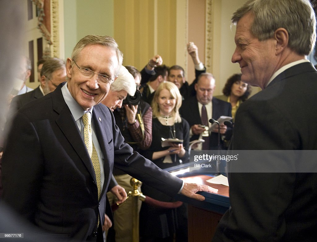 From left, Senate Majority Leader Harry Reid, D-Nev., Sen. Chris Dodd, D-Conn., and Sen. Max Baucus, D-Mont., wait for reporters to arrive before starting their news conference following the Senate Democrats' lunch meeting on Oct. 15, 2009.