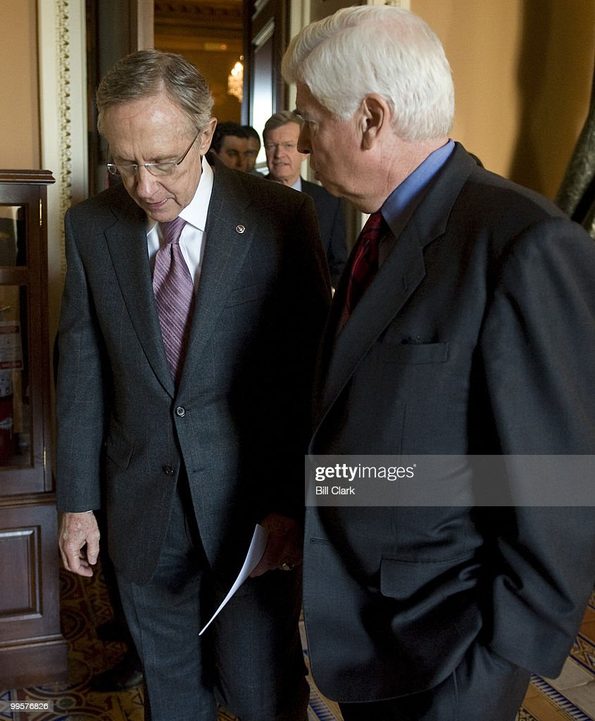 From left, Senate Majority Leader Harry Reid, D-Nev., Sen. Max Baucus, D-Mont., and Sen. Chris Dodd, D-Conn., leave the Senate Democratic Policy lunch to speak with reporters in the Ohio Clock Corridor on Tuesday, Oct. 20, 2009.