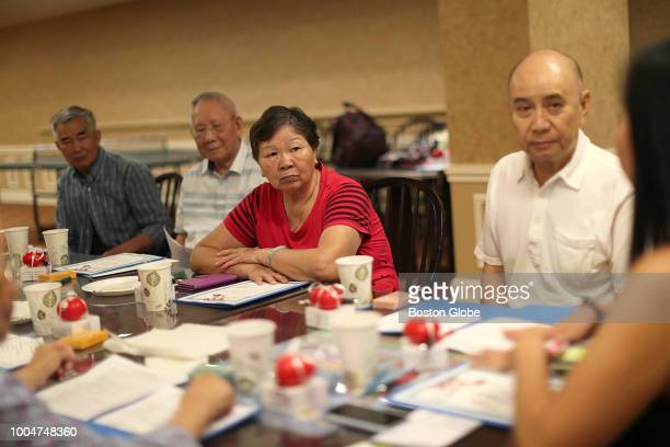 From left senior residents Ding Guo Li Guo Xian Mei Cai Rong Li and Eugene Chen listen during a 'Heart to Heart Cafe' at the Kenmore Abbey Apartments...