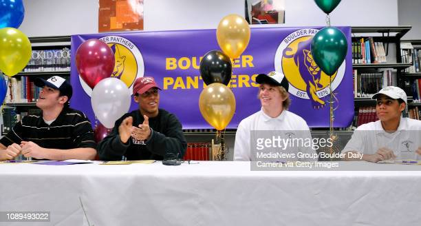 From left seniors Nick Candler Matthew Hanson Will Pericak and JB Hall listen to football coach Spencer Colter after all signing letters of intent...