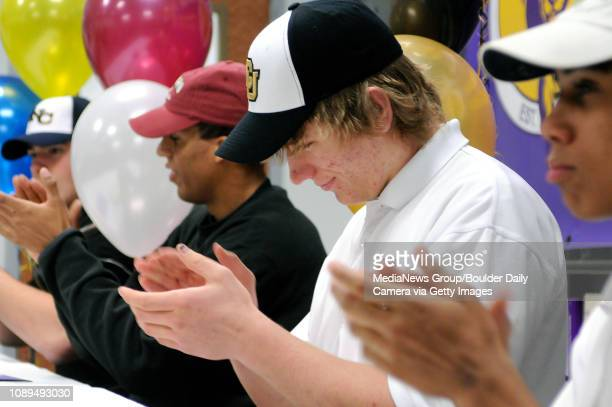 From left seniors Nick Candler Matthew Hanson Will Pericak and JB Hall applaud after signing letters of intent for a National Signing Day ceremony at...