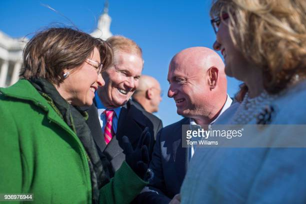 From left Sens Amy Klobuchar DMinn Bill Nelson DFla Mark Kelly and his wife former Rep Gabrielle Giffords DAriz are seen after a news conference at...