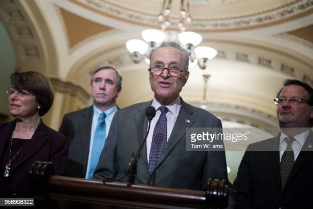 From left Sens Amy Klobuchar DMinn Jeff Merkley DOre Senate Minority Leader Charles Schumer DNY and Sen Gary Peters DMich conduct a news conference...