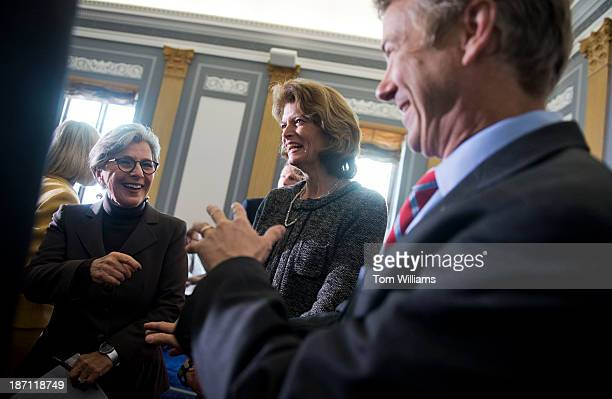 From left Sens Barbara Boxer DCalif Lisa Murkowski RAlaska and Rand Paul RKy arrive for a new conference in Russell Building on creating a military...