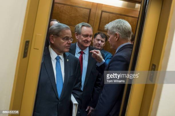 From left Sens Bob Menendez DNJ Mike Crapo RIdaho Mike Rounds RSD and Bill Cassidy RLa board an elevator before the Senate Policy luncheons in the...