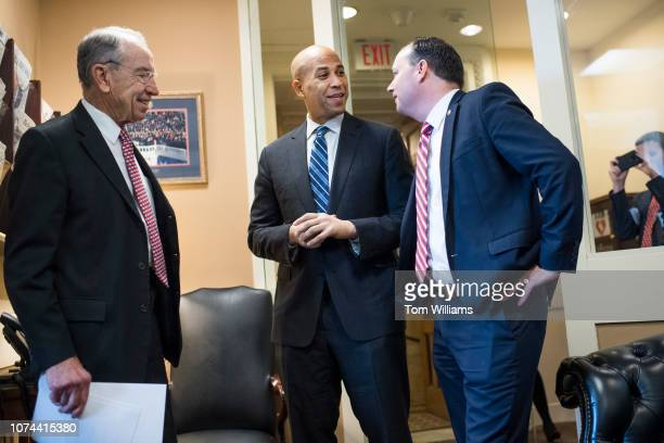 From left Sens Charles Grassley RIowa Cory Booker DNJ and Mike Lee RUtah arrive for a news conference in the Capitol on the passage of the criminal...