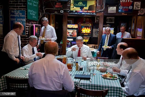 From left, Sens. Chis Coons, D-Del, Max Baucus, D-Mont., Reps. Erik Paulsen, R-Minn., John Delaney, D-Md., Jim Matheson, D-Utah, Lindsey Graham,...