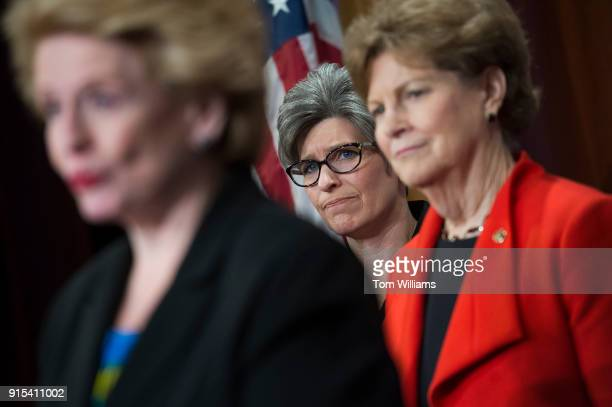 From left Sens Debbie Stabenow DMich Joni Ernst RIowa and Jeanne Shaheen DNH conduct a news conference in the Capitol on February 7 to announce a...