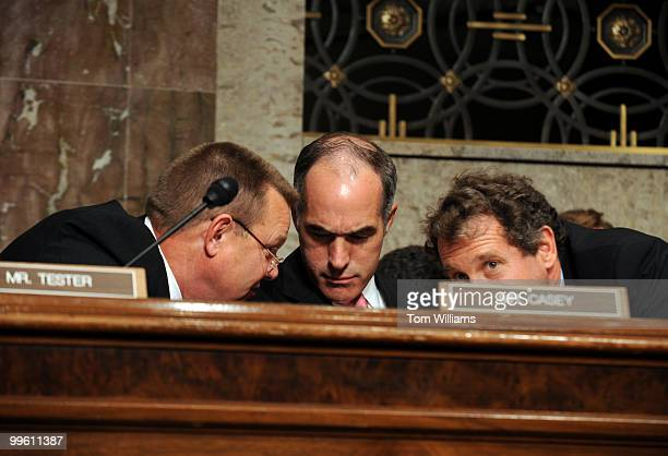 From left Sens Jon Tester DMont Bob Casey RPa and Sherrod Brown DOhio confer during a Senate Banking Housing and Urban Affairs Committee hearing the...