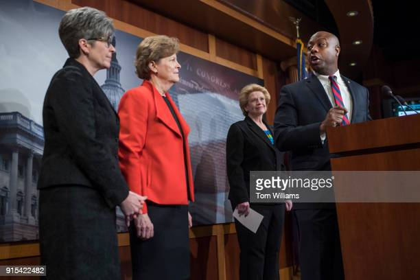 From left Sens Joni Ernst RIowa Jeanne Shaheen DNH Debbie Stabenow DMich and Tim Scott RSC conduct a news conference in the Capitol on February 7 to...