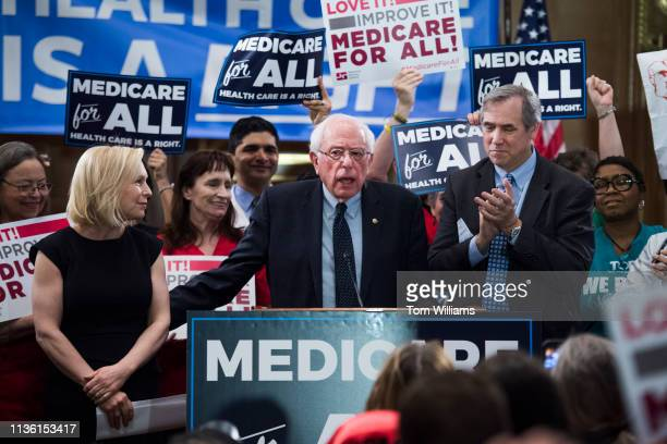 From left Sens Kirsten Gillibrand DNY Bernie Sanders IVt and Jeff Merkley DOre conduct an event to introduce the Medicare for All Act of 2019 in...