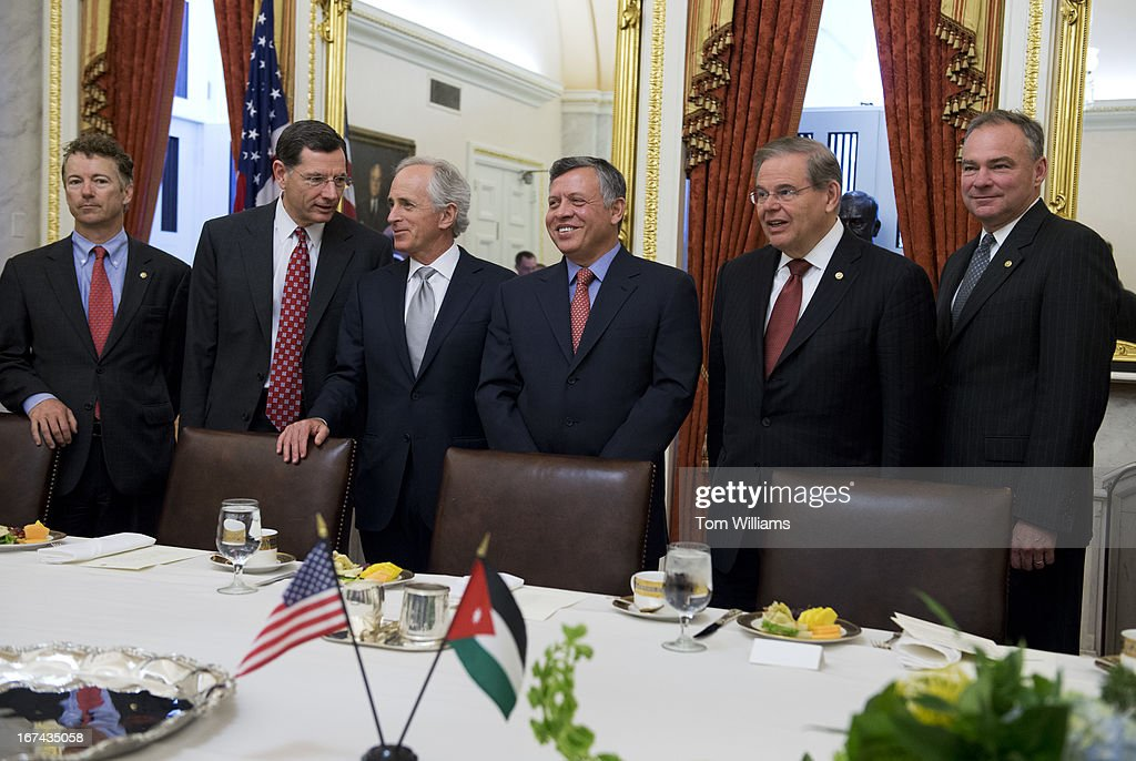 From left, Sens. Rand Paul, R-Ky., John Barrasso, R-Wyo., Bob Corker, R-Tenn., King Abdullah II of Jordan, Sens. Bob Menendez, D-N.J., and Tim Kaine, D-Va., pose for a photo before a lunch meeting in the Capitol with members of the Senate Foreign Relations Committee.