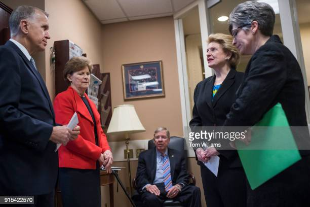 From left Sens Them Tillis RNC Jeanne Shaheen DNH Johnny Isakson RGa Debbie Stabenow DMich and Joni Ernst RIowa prepare for a news conference in the...