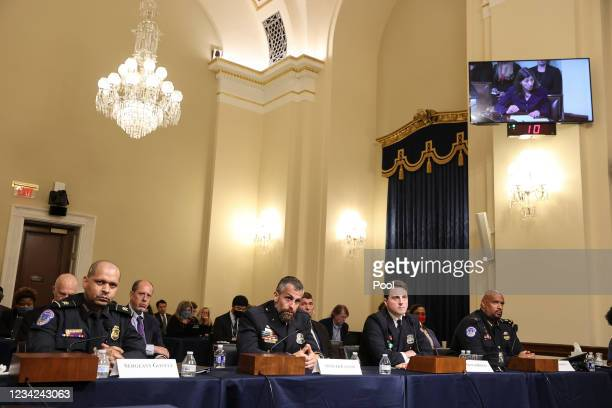 From left, Sgt. Aquilino Gonell of the US Capitol Police, Officer Michael Fanone of the DC Metropolitan Police, Officer Daniel Hodges of the DC...