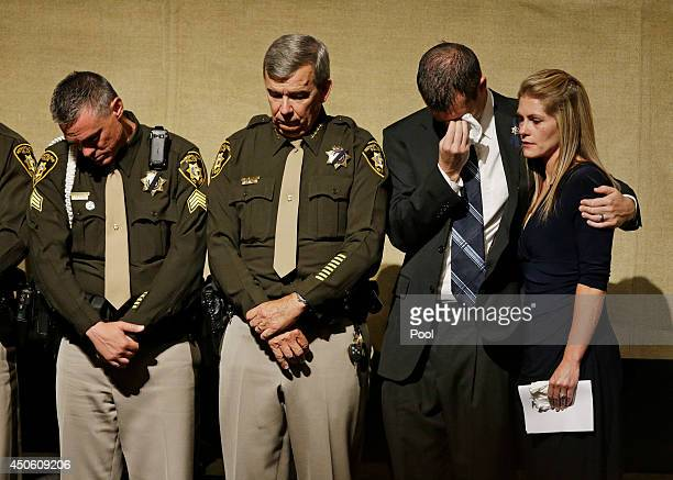 From left Sgt Jimmy Oaks Clark County Sheriff Doug Gillespie Joseph Beck and Elizabeth Krmpotich attend a memorial service for Las Vegas Metropolitan...