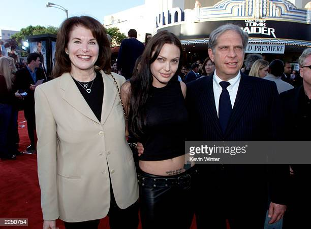 From left Sherry Lansing Angelina Jolie and Jonathon Dolgen arrive for the premiere of the film 'Lara Croft Tomb Raider' at Mann Village Theatre in...